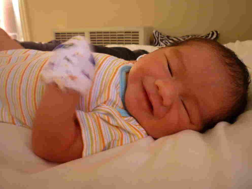 "Maximilian Dominic Mecenas-Sarmiento, born Aug. 17, ""smiles"" for the camera."