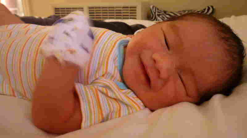 "Maximilian Dominic Mecenas-Sarmiento, born Aug. 17, ""smiles"" for the camera."