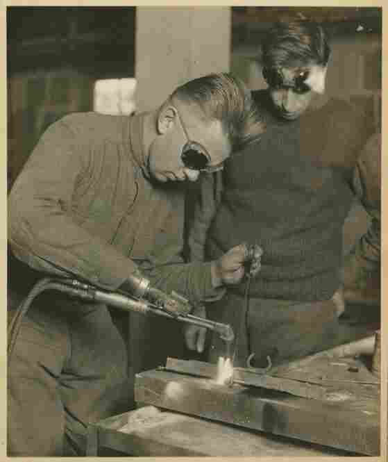 A patient practices welding with a prosthetic arm. Occupational therapy has been a part of Walter Reed's mission since its inception in 1909.