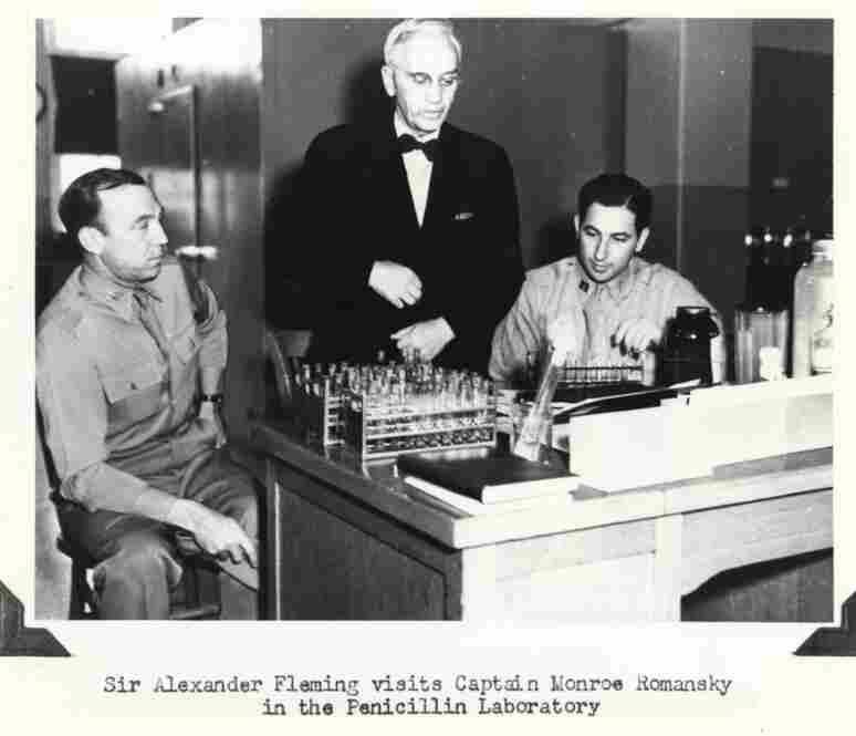 Sir Alexander Fleming (middle), discoverer of penicillin, visits Army Capt. Monroe Romansky (right) in 1945. While working at Walter Reed during World War II, Romansky developed a beeswax and peanut oil carrier that extended Fleming's penicillin shot from every three hours to single, daily injections.