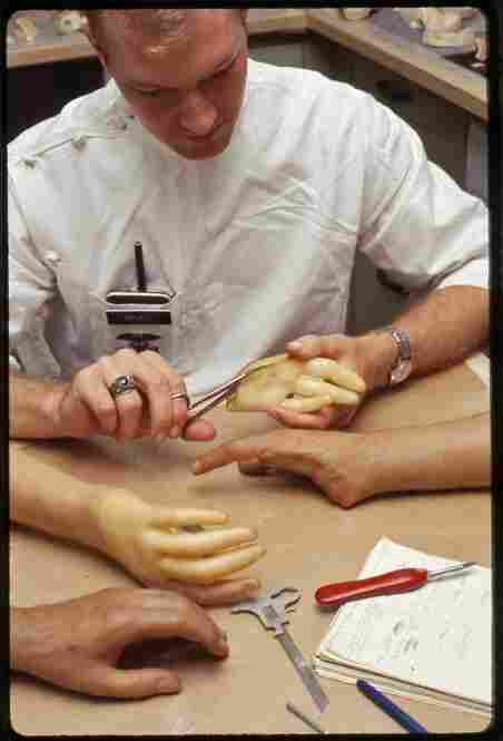 A technician works on a set of lifelike hands in the 1960s. For as long as Walter Reed has been around, it has been creating improved prostheses for injured veterans.