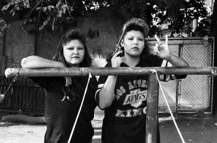 BooBoo (right) flashes a Playboys gang hand sign, 1993.