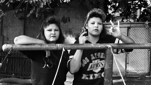 BooBoo (right) flashes a Playboys gang hand sign, 1993. (Robert Yager)