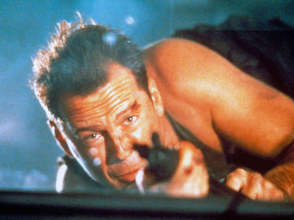 Bruce Willis as John McClane in the 1988 film Die Hard.