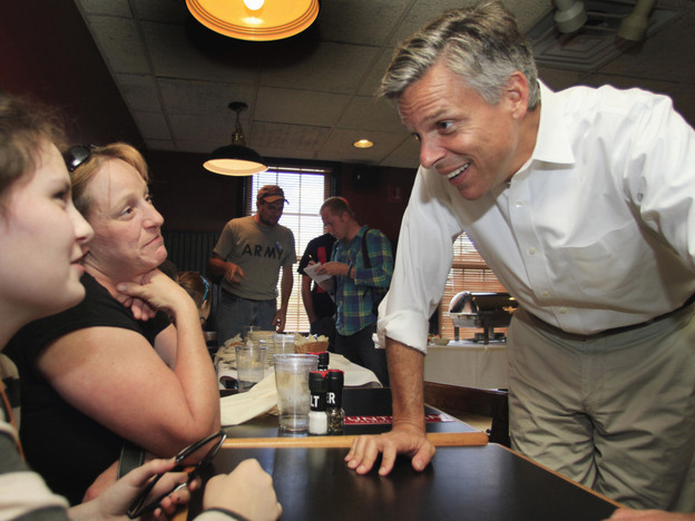 Huntsman, campaigning last month in the Granite State, speaks with Sara Brothers (left) and Rebecca Brothers at the Barley House restaurant in Concord.