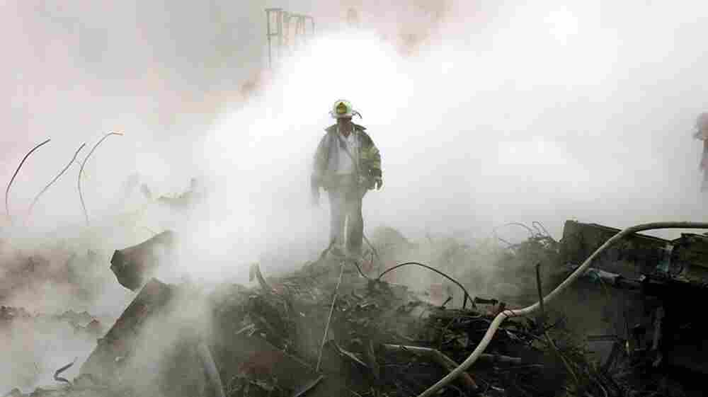 A fireman walks amongst the rubble and the smoldering wreckage of the World Trade Center in New York in the wake of the Sept. 11, 2001, attacks.