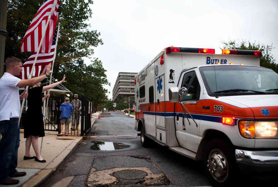Supporters from the D.C chapter of Free Republic send off the final patients from Walter Reed Army Medical Center on Saturday.