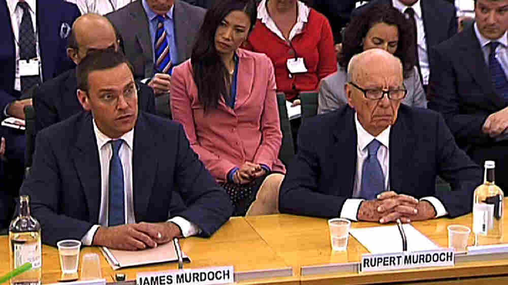 "News Corp. Chief Executive Rupert Murdoch (right), testifying alongside his son James, said his appearance before a British parliamentary inquiry in London was ""the most humble day of my life."""