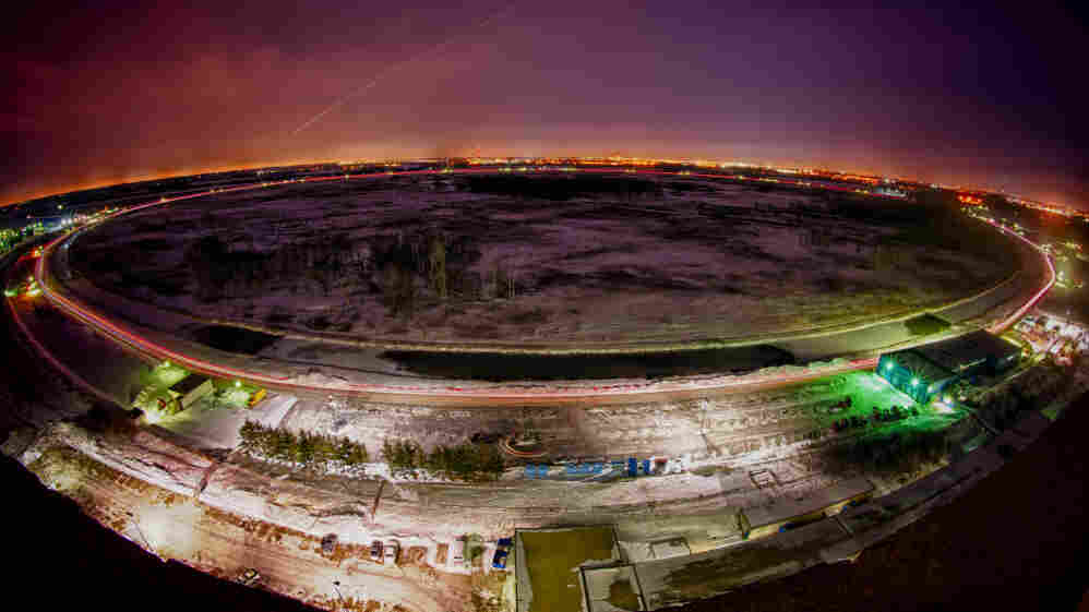 Vehicle lights and shooting stars illuminate the four-mile-long Tevatron ring.