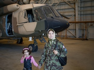 Col. Latifa Nabizada, the only female pilot in Afghanistan, flies her helicopter to some of the most dangerous parts of the country. Her 5-year-old daughter, Malalai, is often with her in the cockpit.