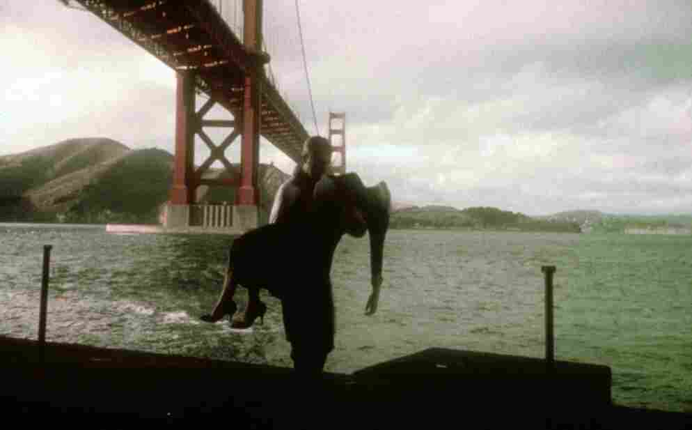 James Stewart carries Kim Novak in the shadow of the Golden Gate Bridge in a scene from Alfred Hitchcock's Vertigo.