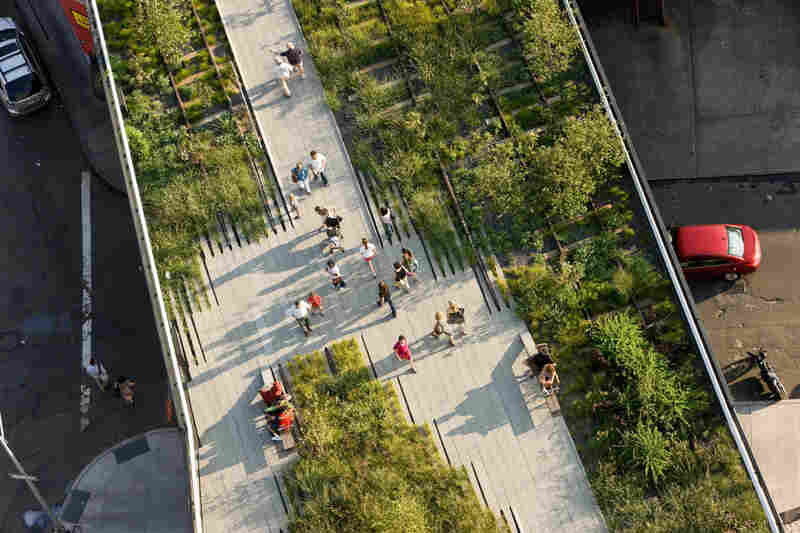 The High Line's Washington Grasslands sit below the Standard, a hotel that was built above the historic rail line.