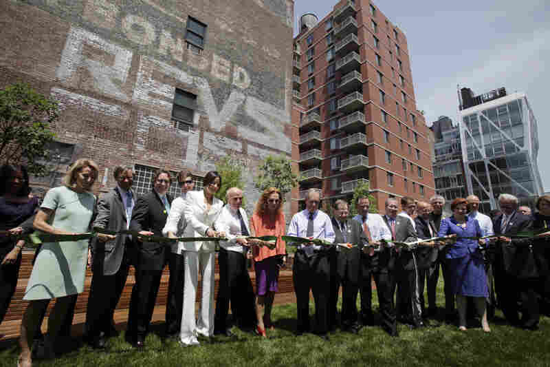 Supporters of the High Line, including Mayor Michael Bloomberg (center), celebrate the opening of the park's second section on June 7. Friends of the High Line founders Joshua David and Robert Hammond cite Bloomberg's election as a turning point in their 10-year effort to save the historic rail line.