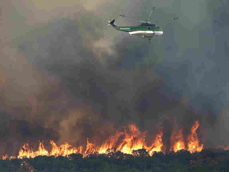 A helicopter returns to the lake to refill its tank for a water drop on fires on Aug. 31, 2011 near Possum Kingdom Lake, Texas. By Monday, the worst fire was in Bastrop County, just southeast of Austin, where the  blaze had been burning out of control for more than a day.