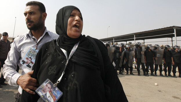 A woman bearing a picture of a relative killed during bloody anti-government demonstrations this year waited outside the Cairo court where former President Hosni Mubarak's trial resumed Monday.