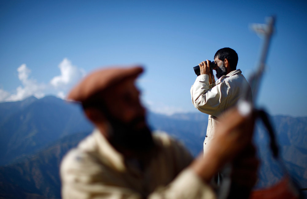 A member of the Afghan Security Guards keeps a watchful eye on the mountains surrounding the Kunar River Valley.
