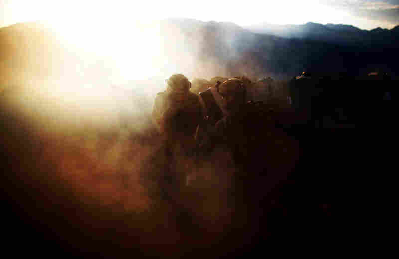 Pfc. Natan Martinez (left) and Spc. Frederick (right) fire an explosive round at a suspected enemy.