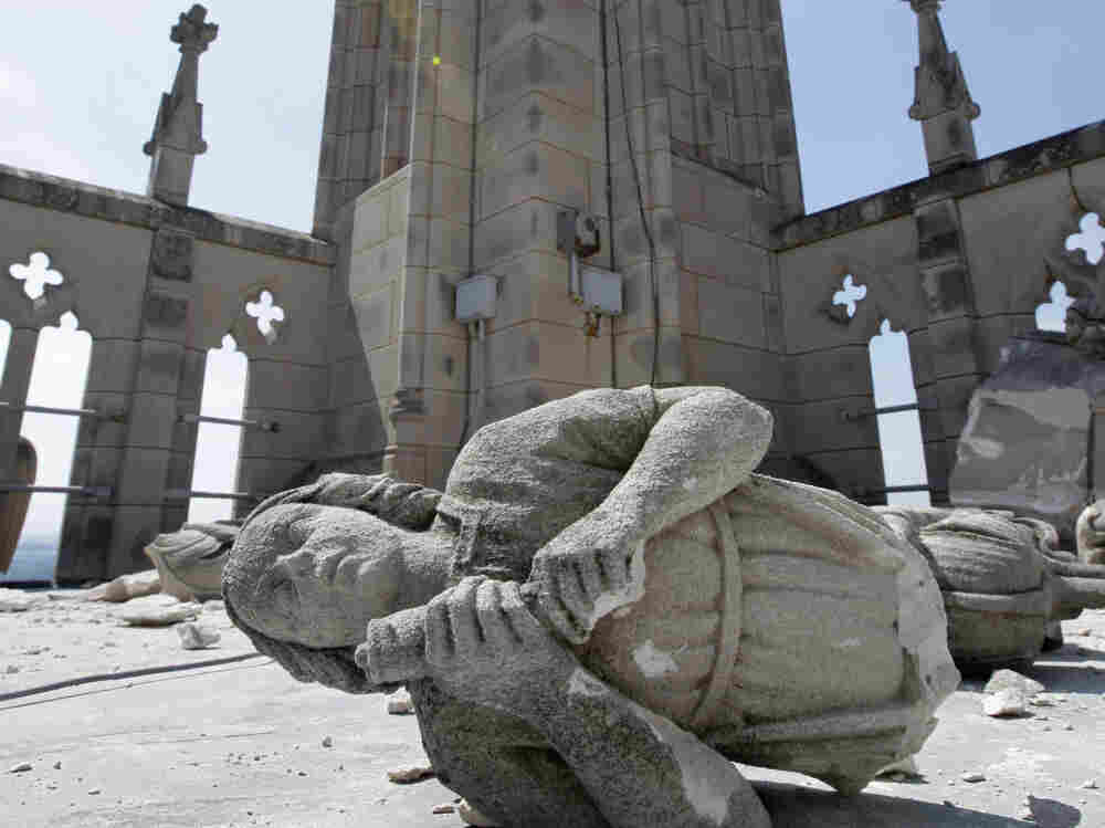 "An angel, carved from Indiana limestone, lies shattered amid other damage on the roof of the Washington National Cathedral after an  earthquake struck on August 23. The cost of repairs could run ""well into the millions,"" a church official said."