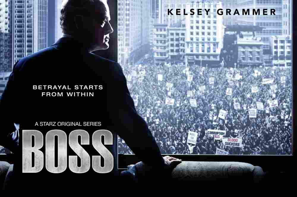Kelsey Grammer looking darkly out a window in Starz' new series, Boss.
