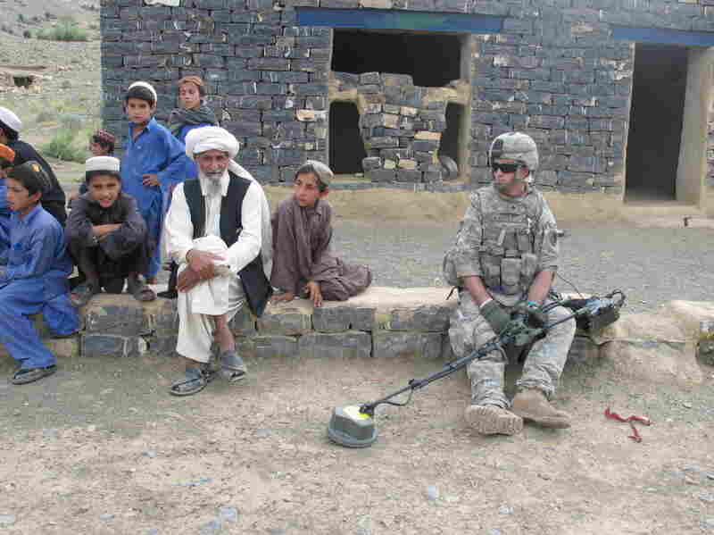Dom's tour of duty takes him to rural Afghanistan, where he works to clear IEDs.
