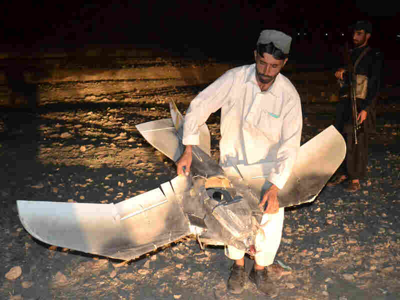 A Pakistani villager holds the wreckage of  a suspected surveillance drone that crashed in the Pakistani town of Chaman along the Afghanistan border on Aug. 25. The number of drone strikes has increased fivefold during the Obama administration.