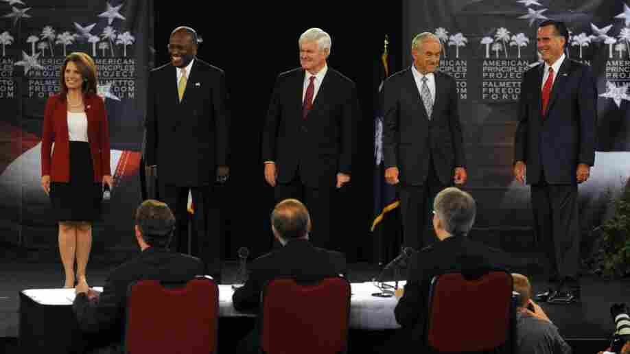 GOP presidential candidates meet at a forum in South Carolina Monday. From left to right, Rep. Michele Bachmann, businessman Herman Cain, former House Speaker Newt Gingrich, Rep. Ron Paul and former Mass. Gov. Mitt Romney. Texas Gov. Rick Perry was not at the event.