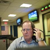 At a fusion center in Las Vegas workers like Daniel Burns, a program coordinator, analyze suspicious activity reports.