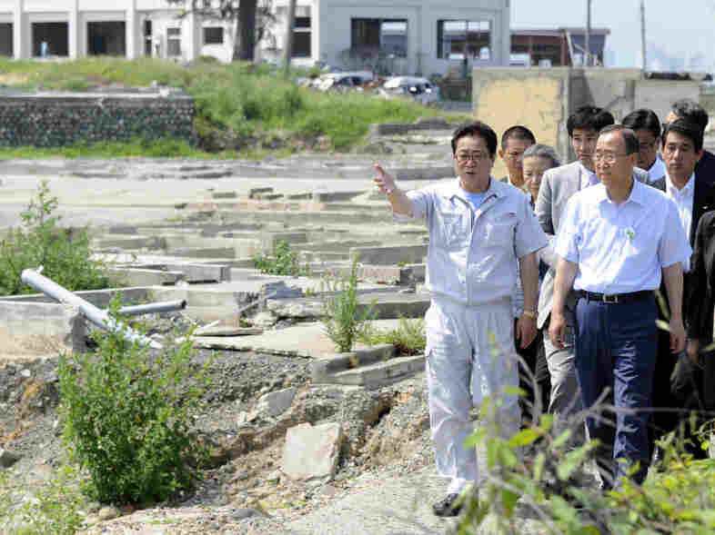 United Nations Secretary General Ban Ki-moon (right) receives an Aug. 8  tour around a devastated area in northern Japan. The nuclear accident linked to the tsunami has turned many Japanese against nuclear power.