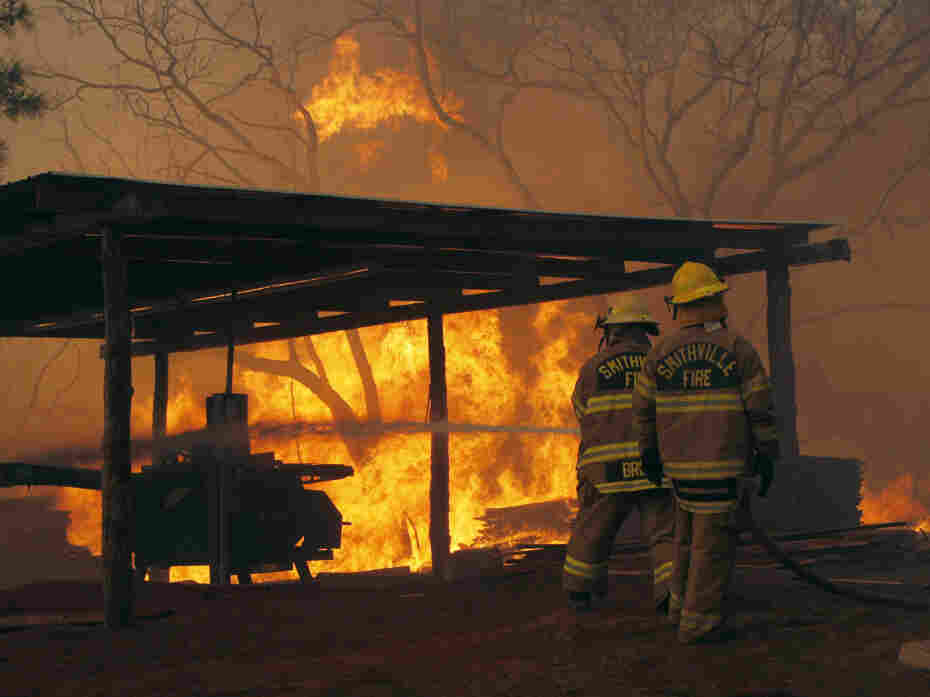 Firefighters at a blaze on Highway 71 near Smithville, Texas, on Monday.