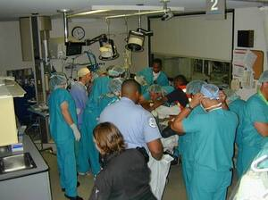 This photo shows one of the trauma bays on Sept. 11, 2001. Dr. James Jeng is in the lower right hand corner in the green scrubs, putting on a face mask.