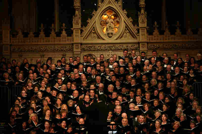 "Conductor Julian Wachner with the six choirs during ""Remember to Love: Let Us Love One Another With A Sincere Heart."""