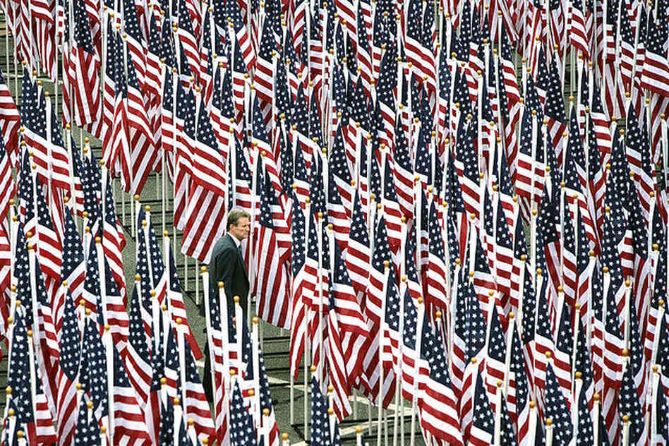 A man walks through the Healing Field flag display near the Pentagon Memorial prior to the dedication ceremony Sept. 11.