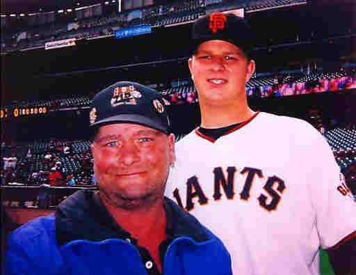 Billy (left) poses for a photo with San Francisco Giants' Pitcher Matt Cain.
