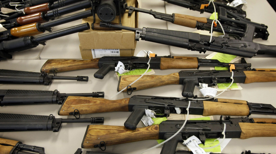 """Part of a cache of seized weapons is on display at a news conference in Phoenix in January. The ATF has been under fire over a failed gun-trafficking operation known as """"Fast and Furious,"""" in which agents allegedly allowed weapons to be smuggled into Mexico."""