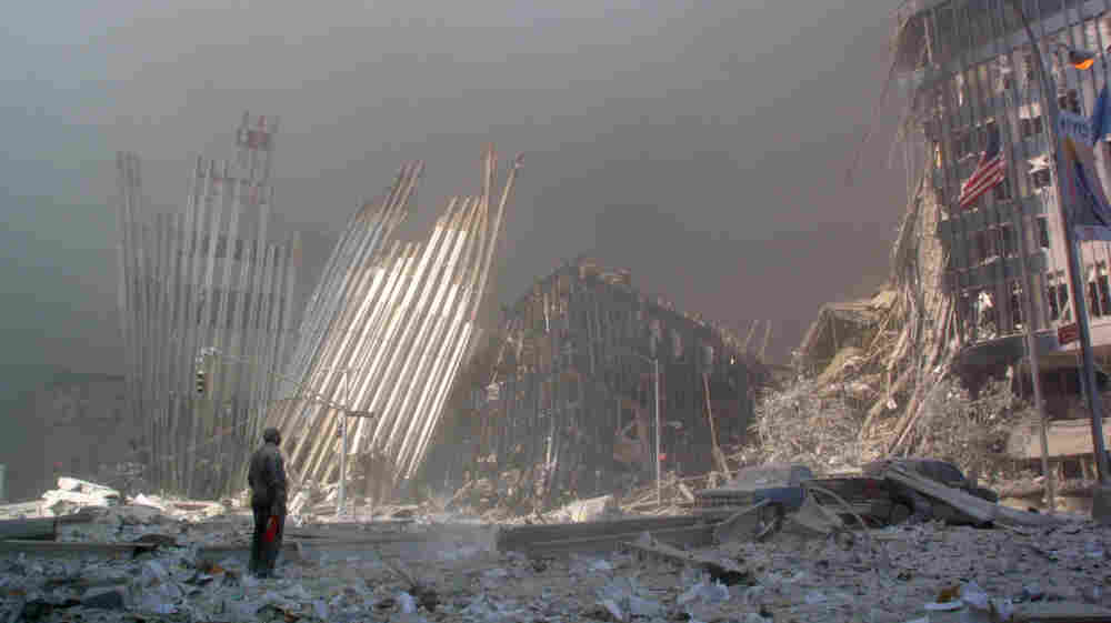 Standing amid the rubble, a man calls out to potential survivors after the collapse of the first World Trade Center Tower in New York City on Sept. 11, 2001. Fifteen Saudis were among the hijackers who carried out the Sept. 11 attacks.