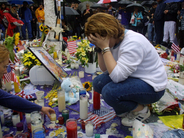 Toni Ann Costa mourns the victims of the World Trade Center disaster on Sept. 14, 2001.