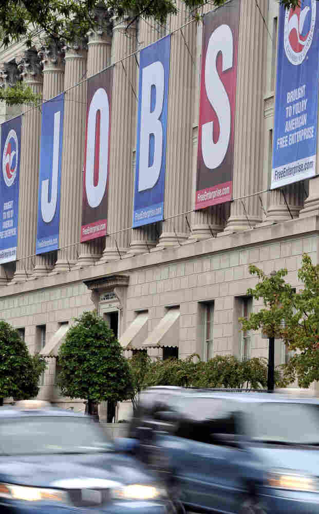 """A giant sign reading """"jobs"""" hangs outside the US Chamber of Commerce building in Washington on September 06, 2011."""