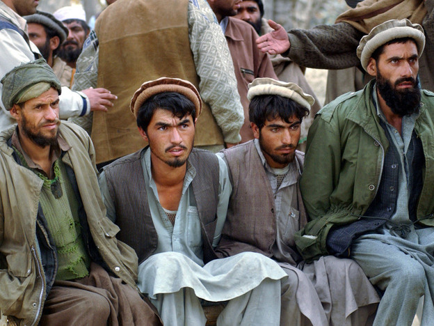 Captured Taliban and al-Qaida soldiers are held near Tora Bora, Afghanistan, in December 2001. The U.S. has forced al-Qaida from its original stronghold, but it has regrouped in other countries.