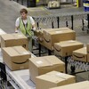 Stephen Guymon, of Twin Falls, Idaho, separates packages for final shipment inside the 800,000-square-foot Amazon.com warehouse in Goodyear, Ariz.