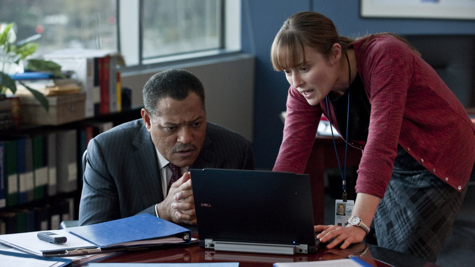 Bug Chasers: Laurence Fishburne and Jennifer Ehle are among the researchers pursuing a treatment for what quickly becomes a global pandemic. (Warner Bros.)