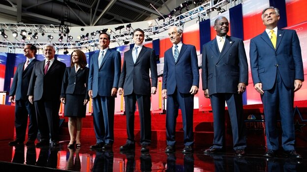 Candidates (L to R) Rick Santorum, Newt Gingrich, Rep. Michele  Bachmann, Mitt Romney, Texas Gov. Rick Perry, Rep. Ron Paul, Herman Cain and Jon Huntsman, Jr. take the stage before the  start of the Ronald Reagan Centennial GOP Presidential Primary  Candidates  Debate at the Ronald Reagan Presidential Library Wednesday in Simi Valley, Calif.