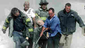 "A mortally injured Father Mychal Judge is carried out of the World Trade Center by first responders, including Bill Cosgrove (in white shirt). Cosgrove says, ""everybody you see in that picture was saved"" from the North Tower's collapse, moments later."