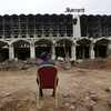 A  Pakistani security guard sits on a chair amid the wreckage of the Marriott Hotel in Islamabad on Sept. 22, 2008, two days  after a suicide bombing at the hotel.