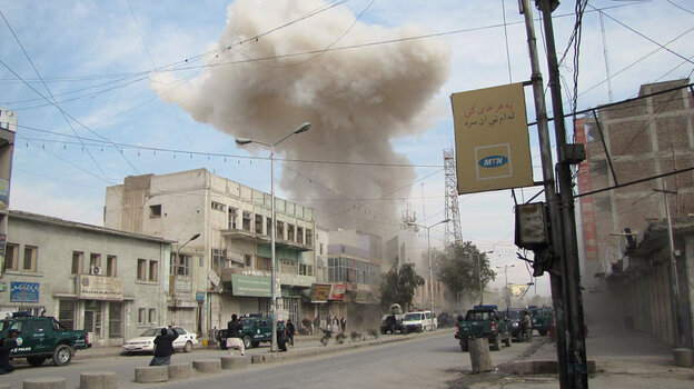 Jalalabad, in Afghanistan's mountainous eastern region along the border with Pakistan, is the last place Osama bin Laden was seen before he vanished in 2001. In this photo from February 2011, smoke rises from an area where Taliban suicide bombers detonated their devices at a bank.