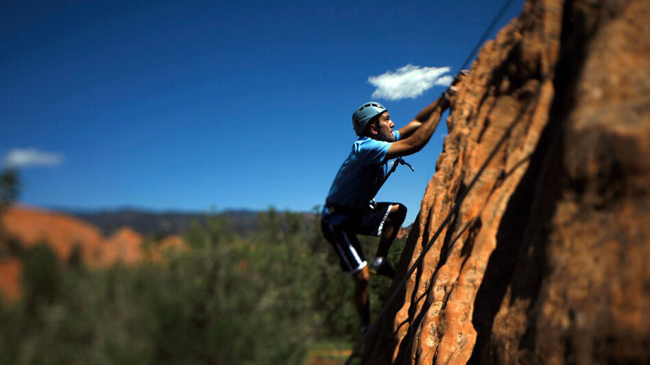 Iraq War veteran Tyler Daly goes rock climbing in Colorado. (NPR)