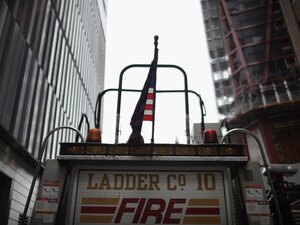 A firetruck is parked near the  nearly completed Freedom Tower at the World Trade Center site in New York on Aug.  14.