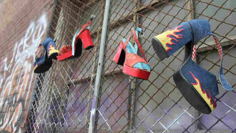 High-heeled shoes  hang from a gated window in an empty alley behind the National Lodge motel. The  Oakland city attorney has filed suit against the motel, arguing that it  knowingly facilitates child sex trafficking.