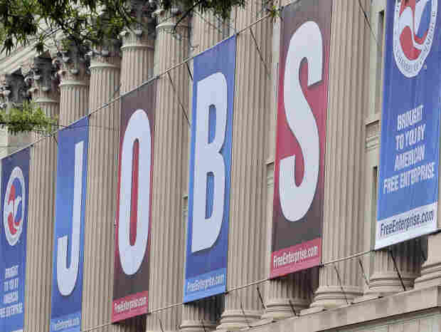 "A giant sign reading ""jobs"" hangs outside the U.S. Chamber of Commerce building in Washington, D.C."