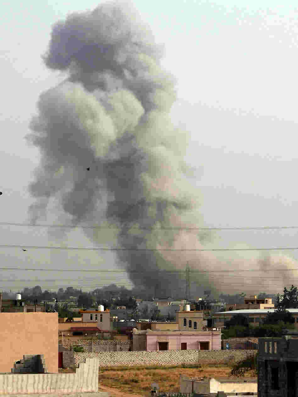 Smoke billows from a suburb of the Libyan capital Tripoli, on June 4, after a NATO air strike. NATO planes bombed Libya for months, assisting rebels who eventually ousted Moammar Gadhafi.