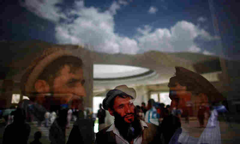 Afghans near the tomb. Massoud supporters say he would have been able to provide much-needed leadership in Afghanistan today. But critics say the selfish and corrupt behavior of some of his followers has tarnished his reputation.